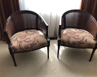 $200 This is a pair of vintage cane barrel back chairs with cane backs and seats that are upholstered in a mosaic look fabric. Solid, real wood construction. Excellent condition with the exception of a tiny thumbprint size hole in the cane on one chair. Not significant, but needs to be mentioned.  Great looking seating at a fantastic offering! (I am including this link to an excellent repair business for caning: https://www.eaststreetartsnh.org/restore should you want to refurbish)