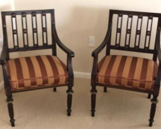 $250 This pair of black ebony side chairs has exquisite details - especially when you see the rosette detail on the backs of the chair. Nicely upholstered silk cushioned seats seal the deal!