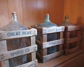 water jugs in crate