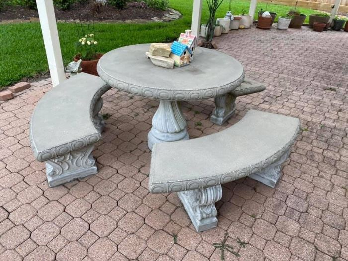 """Round Concrete Patio Table & Benches Excellent condition!  No cracks! Table measures: 43"""" across x 29"""" tall Each bench measures: 53"""" long x 16"""" deep x 17"""" tall. Must be able to move and load yourself. You will need 3-4 strong people."""