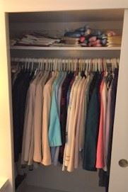 One of the closets with clothes in them.
