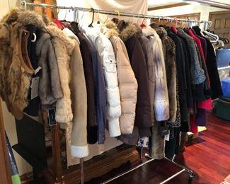so many clothes - many with tags - coats/faux furs