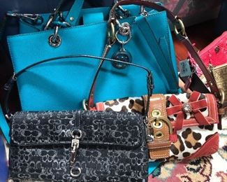 Michael Kors and Coach handbags, new with tags.