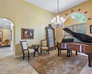 """Yamaha Piano in room setting.  Piano measures 5'8"""".  Round Side Table.  Chairs.  Mirror.  Art Work on Walls and Rug available."""