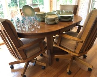 Solid kitchen table with leaf and adjustable chairs