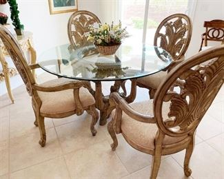 Designer dining set with glass top and 4 upholstered chairs