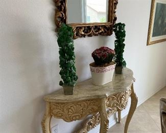 Entry table is carved and marble top