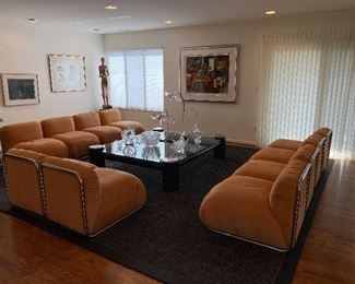 """Directional Sofa $6500 4-seat sections are 105"""" wide x 34"""" deep x 25"""" tall  2-seat section is 53"""" wide x 34"""" deep x 25"""" tall  Measurements are approximate due to puff of cushions."""