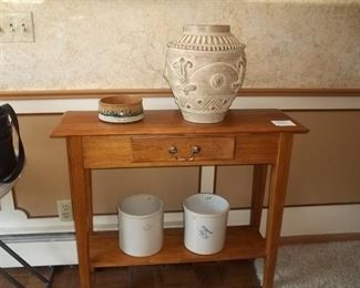 foyer table with drawer and shelf and crocks
