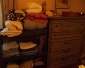 tall chest of drawers and linens and men's clothing