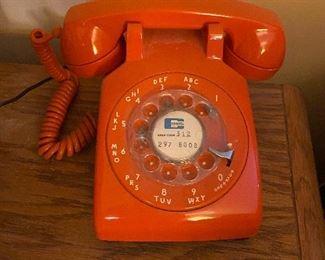 Vintage CENTEL Orange rotary desk telephone