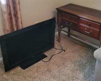 flat tv and small accent table