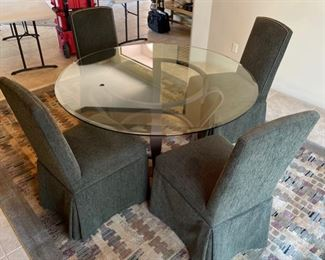 Glass Top Iron Frame Dining table w- 4 upholstered ChairsTable: 3in H x 56in Diameter