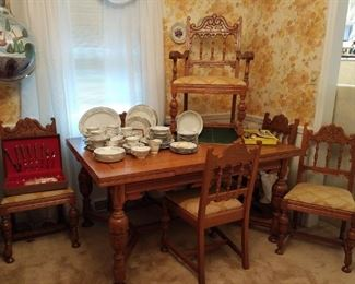 Oak draw leaf table with six chairs to match.  Large set of china