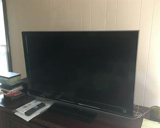 One of three flat screen TVs