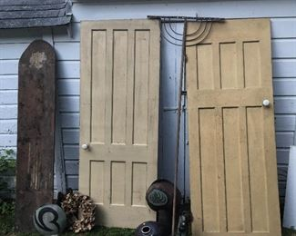 Old doors with porcelain knobs. Wooden antique rake. Art vases. Barnwood galore inside.