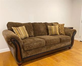Traditional styled sofa with pillows