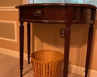 Small demilune table with drawer