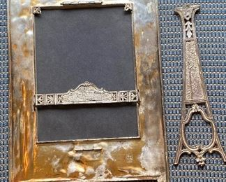 Additional photo of back of frame with designs.  Easel needs to be soldered on.