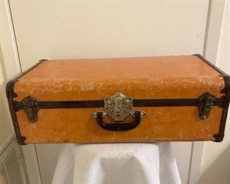"Vintage suitcase with locks. No tears. Unmarked. Measures 25 1/2"" wide, 14"" heigth, 5 1/2"" bottom depth. $22"