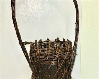 Old woven twig flower holder with metal insert. $20