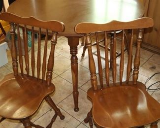 Cochrane maple kitchen table with four chairs and two table inserts.