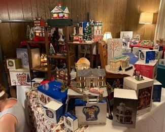 YALL!!!! This is supposed to be the master bedroom, however it was the largest usable room so now it is Dept 56 PALOOZA!!! We have displayed some of our favorites but there is no way to display them all.