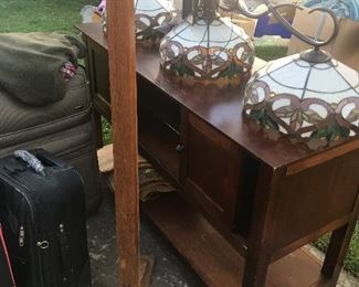 Luggage, modern furniture, several light fixtures.
