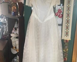 Many textiles including rugs, table clothes, hankies, bedding and a wedding dress!