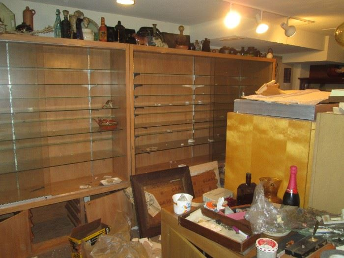 Basement Left Stairs:  Great Display Cases with Glass Shelves and Glass Doors.  There are 3 of them.