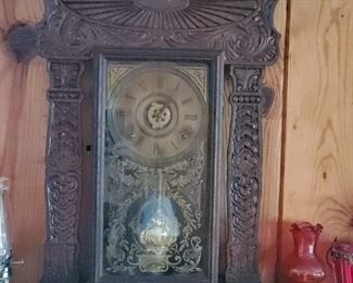 Intricate carved wood mantle clock