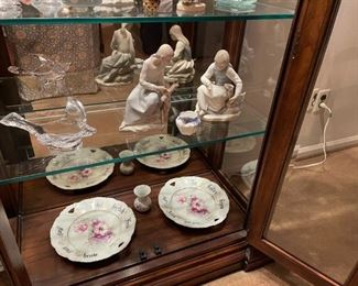 . . . two more Lladros, art glass bird, and European plates