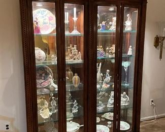 . . . the curio cabinet itself is stunning!
