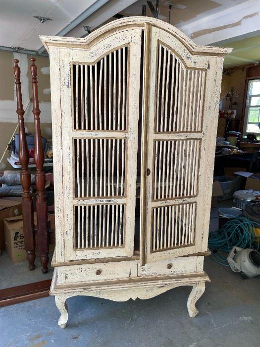 Unique birdcage style entertainment center armoire