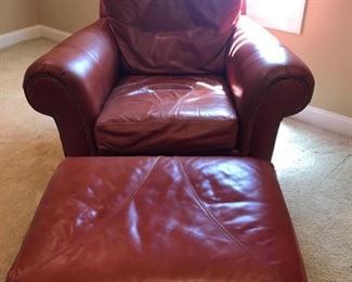 """Very nice burnt orange leather chair with ottoman by Ferguson Copeland, LTD with gold details. It measures 41"""" x 43"""" x 35"""". Cushion height is 5"""". The ottoman measures 23"""" x 30"""" x 18"""". Minimal wear and in great condition. https://ctbids.com/#!/description/share/949822"""