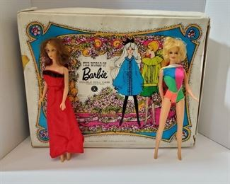"""Barbie and Midge doll with case. Case measures 18x13x5"""". Includes a wonderful collection of Barbie fashions, some homemade and a few pieces with black and white label. Dolls are both stamped 1966 on tush and some slight damage to legs. https://ctbids.com/#!/description/share/949828"""
