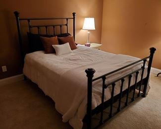 """Brass queen size bed painted black with mattress, boxspring and linens. Bed-frame measures 62x90x59"""", Mattress height 25"""" Sealy mattress and boxspring are older but still comfortable. Mattress measures 60x80"""". https://ctbids.com/#!/description/share/949838"""