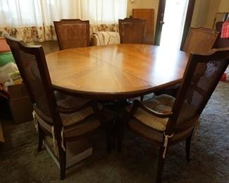 DINNING TABLE, 2 LEAVES,PADS, 6 CAPTAINS CHAIRS, TABLECLOTHS AND NAPKINS