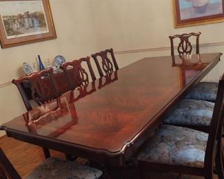 Chippendale Style by Thomasville. Swirl Crotch Mahogany in exquisite condition. 8 chairs, 1 leaf and includes pads