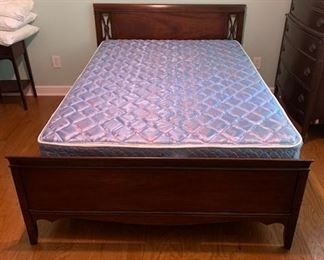 Dixie Furniture Co. bed. The mattress is full, but there is still room on either side, so a queen could fit.