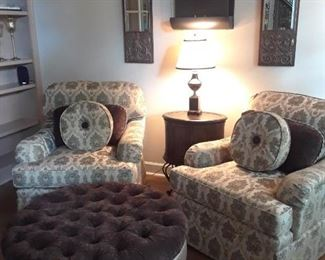 Pair of sumptuously upholstered armchairs