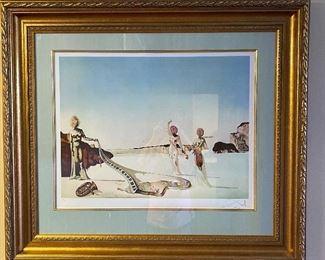 """Signed and numbered Salvador Dali 92/300 Beautifully framed with silk mat and chunky gold leaf frame. """"Three Young Surrealist Women Holding in Their Arms the Skins of an Orchestra"""" 35x38"""""""