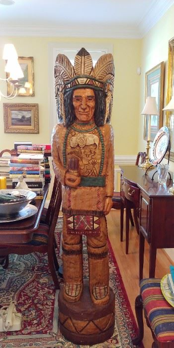 """Wood figures such as this were first created when the Native Americans introduced the English settlers to tobacco in the 1600s. Shop owners would put them outside their stores to let people know that they sold tobacco inside. Fast forward now to the 1840s and a Native American Indian from the Man-Dan tribe started making furniture and carving his own similar sculptures. Following the tradition of many (Indian) laborers of the time, this Native American took his employer's surname and became known as """"Samuel Gallagher"""". And so, the """"Gallaghers"""" and a long line of master craftsman were born! From Samuel, through Ralph (who sadly passed away aged 74 in 2000) and all the way to Frank & John today, the Gallaghers have become synonymous with fine Native American carving. Their pieces from the 1840s are virtually priceless (- indeed one of the original Gallagher sculpture's is on display at the Smithsonian Institute –) but the more modern sculptures also remain most desirable. Today's pieces"""