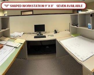 SEVEN U-SHAPED WORK STATIONS. 5 PIECES. PER STATION. CUSTOM MADE. ADJUSTABLE ANGLE ON TOP. (2)-5' X 3' DESKS, 6' SIDE BOARD, 3' SIDE BOARD, 1 BOOKCASE