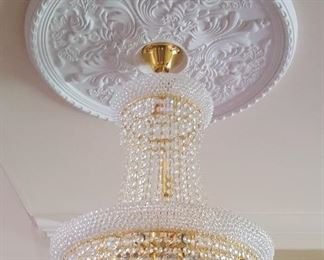 #1 - K9 Crystal Chandelier with 85 crystals and 7 lights. Price - $795.