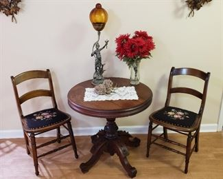 c 1875 Renaissance Revival Walnut Table along with 2 Needle Point Chairs and Figural Lamp