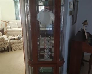 Curio cabinet with glass shelves, and it is lighted, contents sold separately