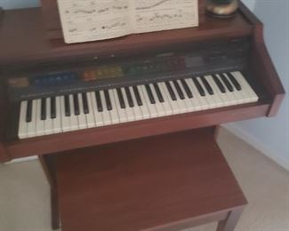 small piano and matching bench