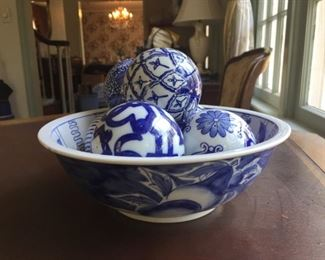 Blue and white bowl with COBALT BLUE AND WHITE CERAMIC DECORATIVE FLORAL CARPET BALLS.