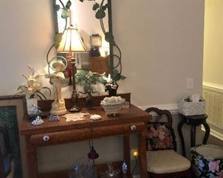 Gorgeous antique table, green ivy mirror, side tables, set of four white bottom chairs, and many beautiful, pristine collectibles.
